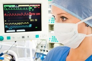 Doctor with surveillance monitor